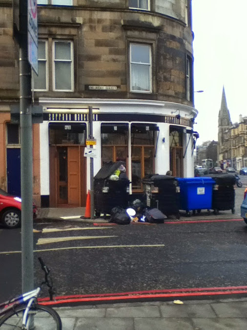 photo of overflowing bins on former of Dalmeny Street and Leith Walk