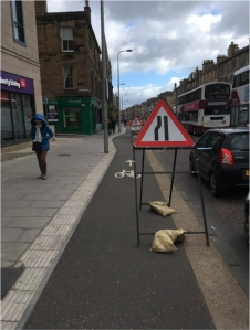photo of sign blocking cycle-path on Leith Walk in 2018